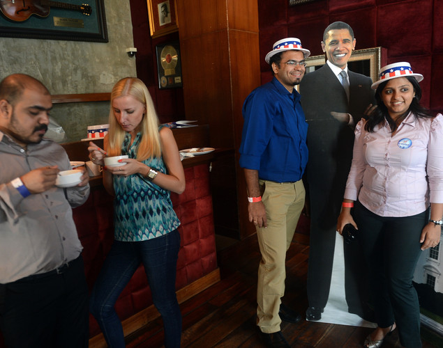 Guests pose for a photograph with a cut-out of US President Barack Obama during an US Election Returns party in Mumbai.