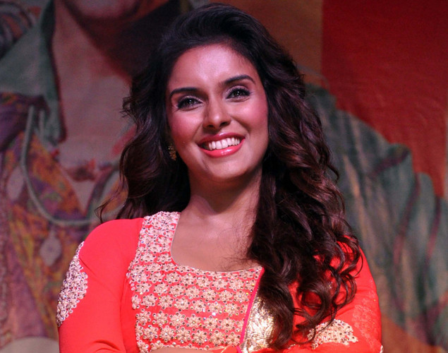 "Indian Bollywood actress Asin Thottumkal poses during a promotional event for the forthcoming Hindi film ""Khiladi 786"" directed by Ashish R Mohan in Mumbai."