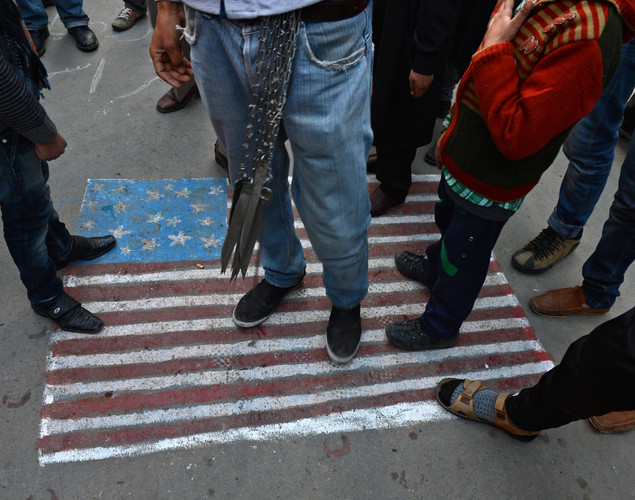 Kashmiri Shiite Muslims step on a US flag painted on the street during a religious procession held on the fourth day of Ashura, which remembers the slaying of the Prophet Mohammed's grandson in southern Iraq in the seventh century, in Srinagar.