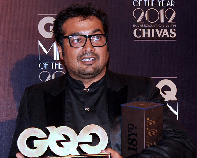 Indian Bollywood film director Anurag Kashyap receives the Best Director award during the 'GQ Men of the Year Awards 2012' in Mumbai.