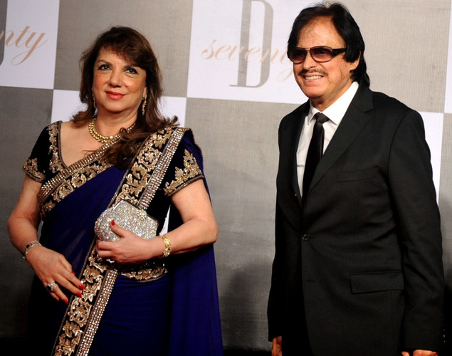 Indian Bollywood actor Sanjay Khan (R) and his wife Zarine arrive to attend the 70th Birthday celebration of Bollywood Actor Amitabh Bachchan in Mumbai.