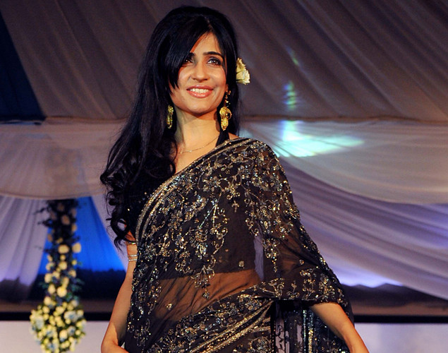 Indian Bollywood singer Shibani Kashyap displays a creation by designer Neeta Lulla during a fashion show entitled Walk of  peace in Mumbai.