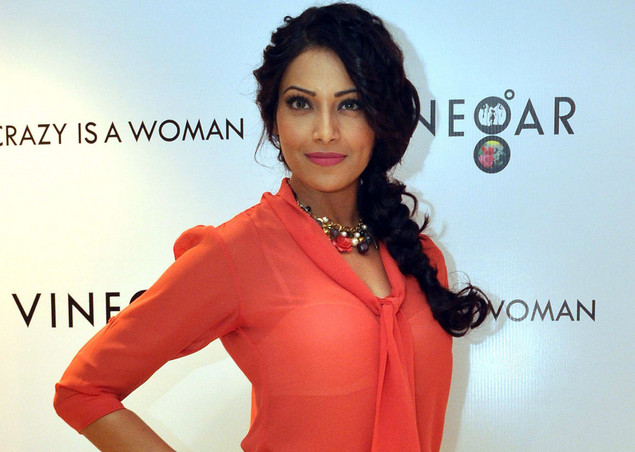 Bipasha Basu poses during the inauguration of the 'Vinegar' show room in Mumbai