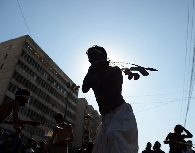 Pakistani Shiite Muslims flagellate themselves during an Ashura procession in Karachi.