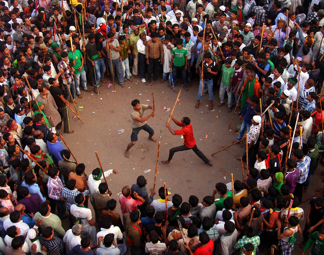 Indian Shiite Muslims participate in a mock fight during a religious procession on the tenth day of Ashura in Allahabad.