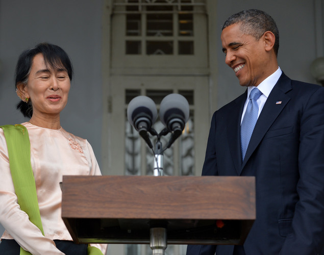 US President Barack Obama (R) and Myanmar opposition leader Aung San Suu Kyi smile after speaking to press at Suki's residence in Yangon.