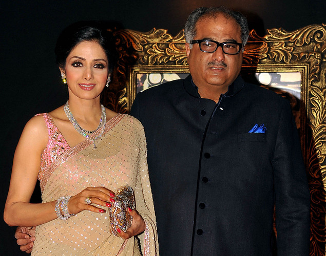 Bollywood film actress Shridevi (L) and her husband Boney Kapoor pose on the red carpet at the premiere of the Hindi film 'Jab Tak Hai Jaan' in Mumbai.