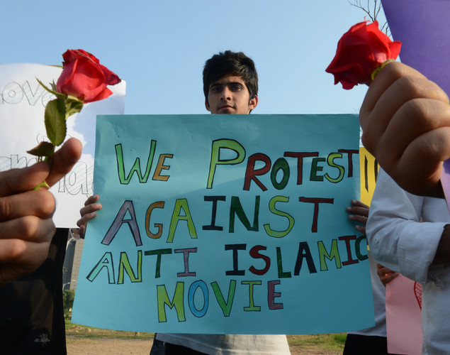 A Pakistani student holds a placard during a protest against the controversial film 'Innocence of Muslims' in Islamabad.