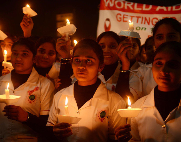 Indian nursing students hold a candlelight vigil on the occasion of World AIDS Day in Amritsar.