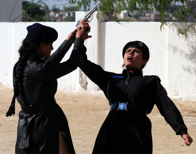 Pakistani women police cadets perform during passing out parade in Karachi.