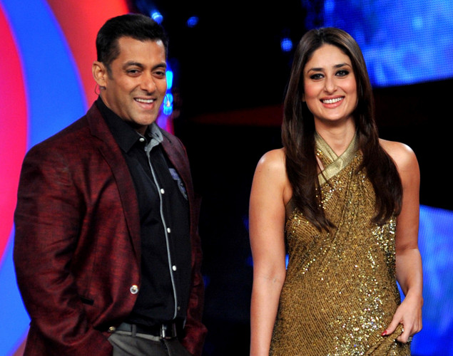Bollywood actress Kareena Kapoor (R) poses with actor Salman Khan on the set of a television show during the promotion of the forthcoming Hindi film 'Dabbang 2' in Lonavala.