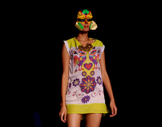 Models present creations by Indian designer Malini Ramani during the fourth day of the Wills India Fashion Week Spring- Summer collection 2013 in New Delhi.