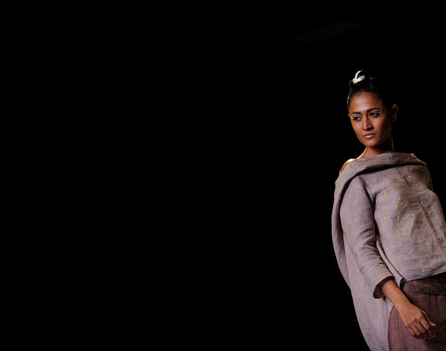 A model presents a creation by Indian designer Wendell Rodricks during the Wills India Fashion Week Spring- Summer collection 2013 in New Delhi.