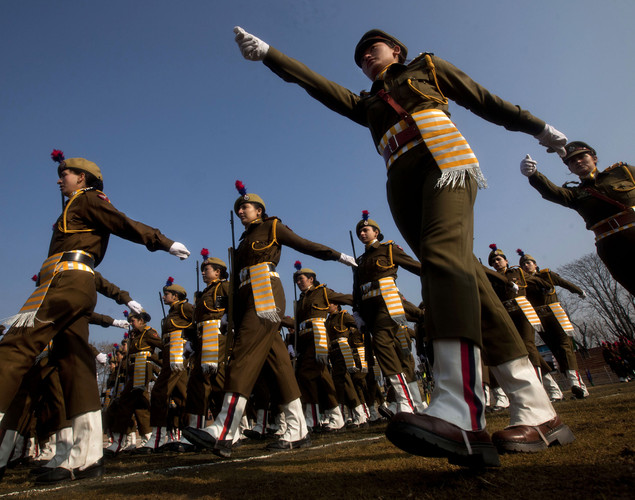 Indian policewomen march during a parade to mark Republic Day in Srinagar, India.