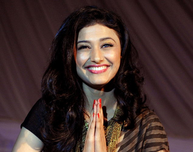 Indian television actress Ragini Khanna displays a creation by designer Neeta Lulla during a fashion show entitled Walk of  peace in Mumbai.