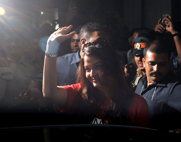 Indian Bollywood actress Aishwarya Rai Bachchan waves before visiting the Lokmanya Tilak municipal medical general hospital to meet children suffering from AIDS in Mumbai.