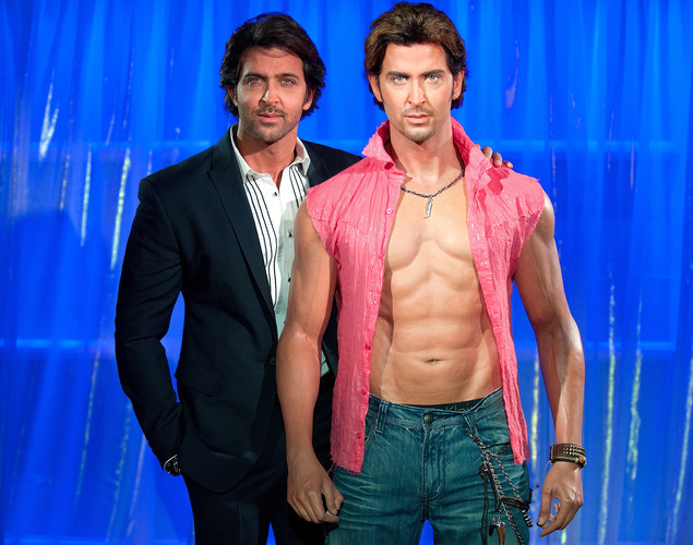 Bollywood actor Hrithik Roshan (L) poses with a wax figure of himself