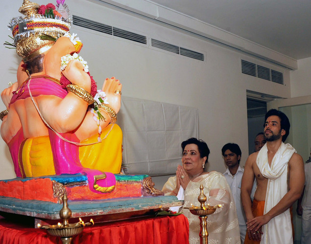Indian Bollywood actor Tusshar Kapoor pose (R) and mother Shobha Kapoor (L) offer prayers to an idol of Hindu God Lord Ganesh during the festival of 'Ganesh Chaturthi' in Mumbai.