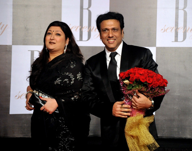 Indian Bollywood actor Govinda (R) poses with his wife Sunita as they attend the 70th Birthday celebrations of Bollywood Actor Amitabh Bachchan in Mumbai.
