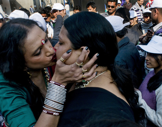 Indian transgender activist Laxmi Narayan Tripathi (L) greets a fellow activist as participants, including transgenders, drug users, sex workers and people living with HIV celebrate at a cultural event following the All-India Run as they observe World Aids Day in New Delhi.