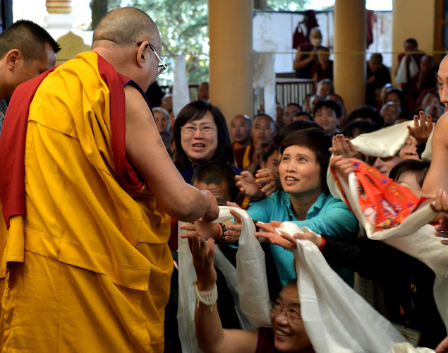 Tibetans spiritual head The Dalai Lama (L) greets Buddhist devotees as he leaves The Namgyal Monastery in Dharamshala.