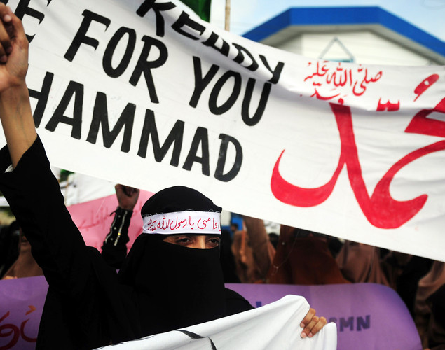 A veiled Pakistani shouts anti-US slogans during a protest against an anti-Islam film at Karachi.