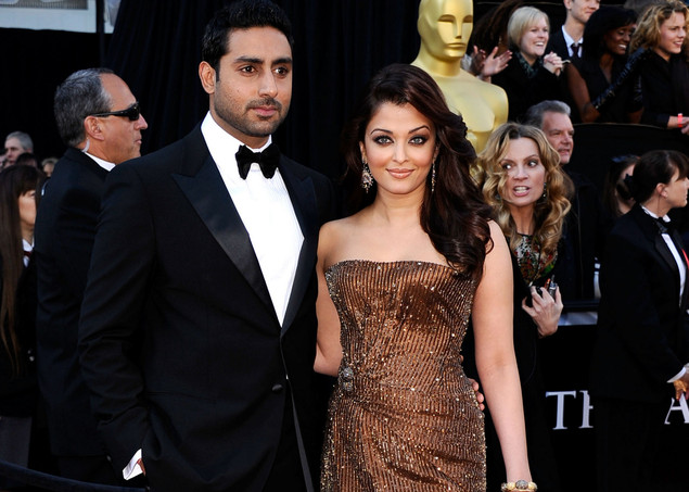 Actress Aishwarya Rai Bachchan (R) Abhishek Bachchan arrive at the 83rd Annual Academy Awards