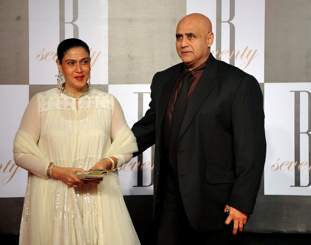 Indian Bollywood actor Puneet Issar (R) arrives with his wife to attend the 70th Birthday celebration of Bollywood Actor Amitabh Bachchan in Mumbai.