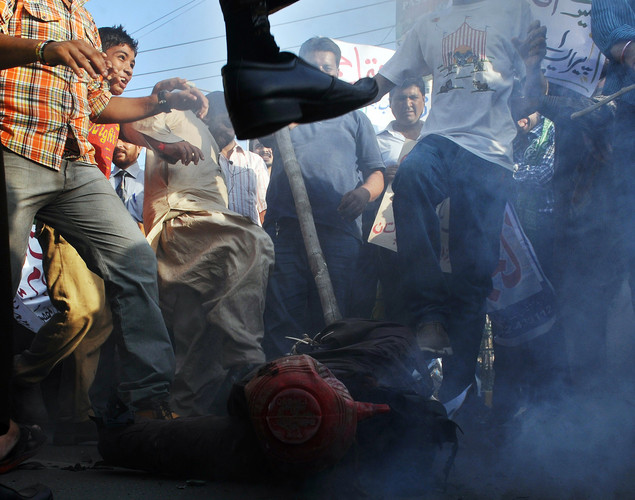 Pakistani demonstrators beat an effigy of Florida pastor Terry Jones during a protest against an anti-Islam film in Lahore.