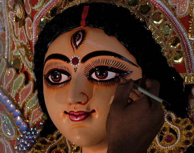 An artist applies a final coat of varnish onto an idol of Hindu Godess Durga on the last day of 'Pitrupaksh' - days for offering prayers to ancestors - at a workshop in Mumbai.