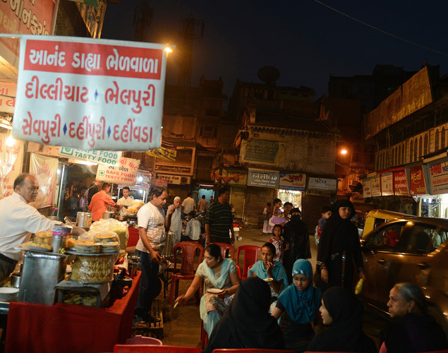 Indians enjoy street food in the walled city of Ahmedabad.