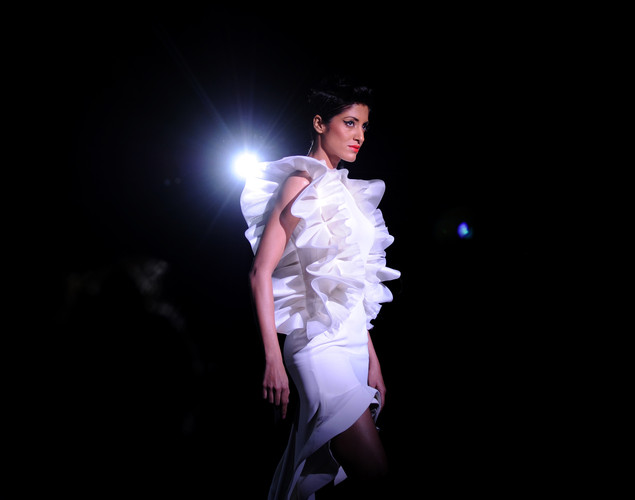 A model presents a creation by Indian designer Gauri and Nainika during the fourth day of the Wills India Fashion Week Spring- Summer collection 2013 in New Delhi.