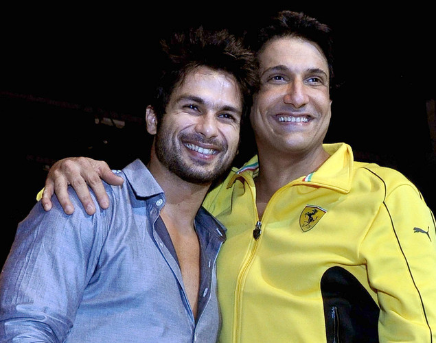 Shahid Kapoor (L) poses for a photo with Summer Funk 2012 dance choreographer Shiamak Davar, during the screening of his pop music video show in Mumbai