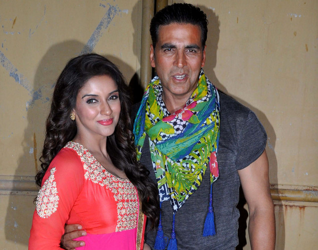 "Indian Bollywood actress Asin Thottumkal (L) poses with actor Akshay Kumar during a promotional event for the forthcoming Hindi film ""Khiladi 786"" directed by Ashish R Mohan in Mumbai."
