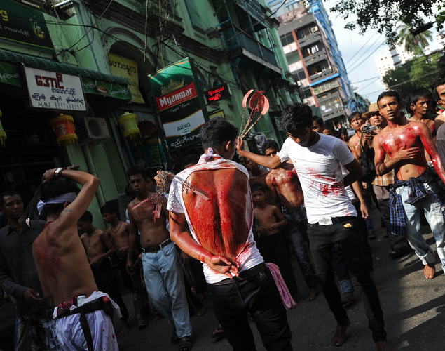 Myanmar Shiite Muslims flagellate themselves during a religious procession in Yangon as part of Ashura celebrations.