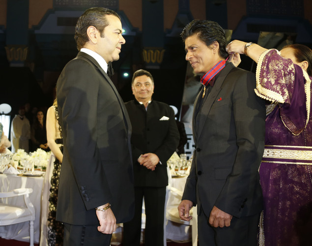 Morocco's Prince Mouley Rachid (L) presnets a medal to Indian actor Shahrukh Khan during the 12th Marrakech International Film Festival.