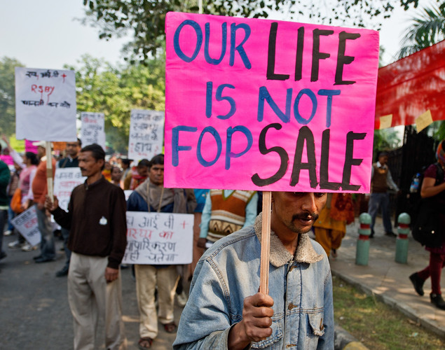 Activists of Network of Positive People hold placards during a rally on the eve of World AIDS day in New Delhi.
