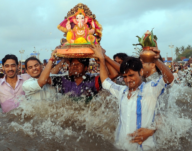 Indian Hindu devotees carry an idol of elephant-headed Hindu god Ganesha as they chant mantras-religious hymns during immersion at the iconic Juhu Chowpatty beach on the fifth day of the ten-day long festival Ganesh Chaturthi, in Mumbai.
