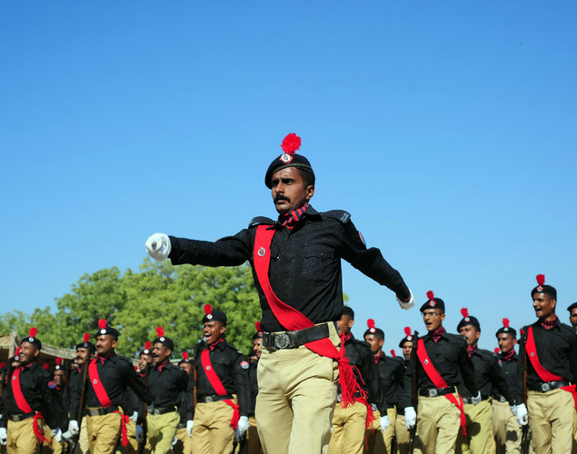 Pakistani police cadets shout during the passing out parade in Karachi.