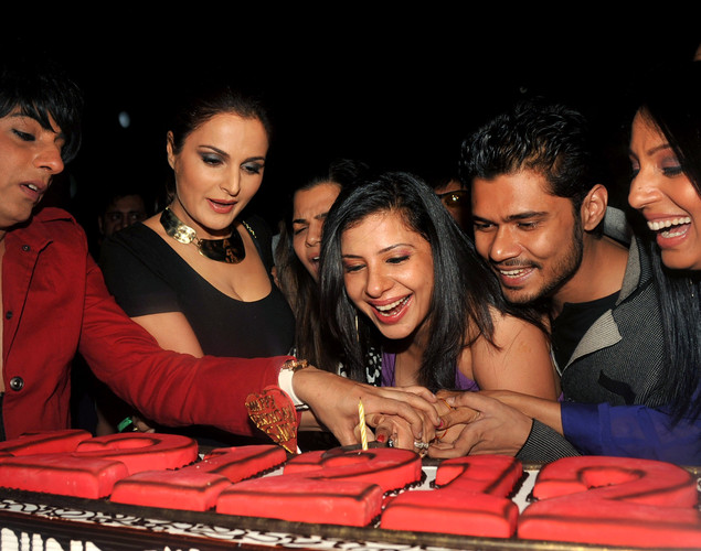 Indian Bollywood dancer and actress Sambhavna Seth, (C), with boyfriend Avinash Diwedi, (2R), designer Rohit Varma, (L), actresses Monika Varma (2L) and Kashmira Shah celebrated her '12.12.12' birthday in Mumbai.