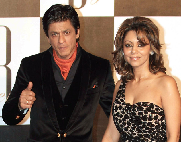 Indian Bollywood actor Shah Rukh Khan (L) poses with his wife Gauri as they attend the 70th Birthday celebrations of Bollywood Actor Amitabh Bachchan in Mumbai.
