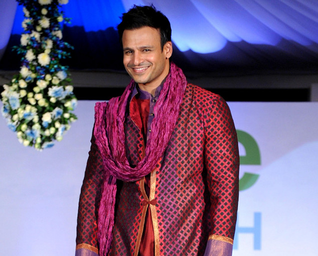 Indian Bollywood actor Vivek Oberoi displays a creation by designer by Krishna Mehta during a fashion show entitled ?Walk of  peace? in Mumbai late November 26, 2012.