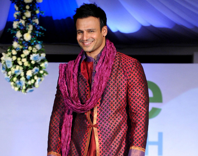 Indian Bollywood actor Vivek Oberoi displays a creation by designer  by Krishna Mehta during a fashion show entitled Walk of  peace in Mumbai.