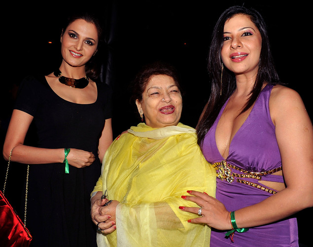 Indian Bollywood film actress Monika Bedi (L) and dance choreographer Saroj Khan (C), with Indian Bollywood dancer and actress Sambhavna Seth, celebrate her '12.12.12' birthday in Mumbai.
