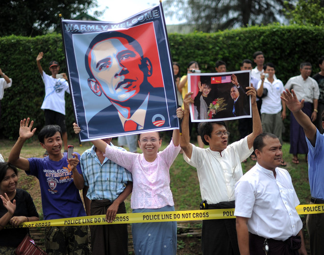 Local residents gather outside Myanmar opposition leader Aung San Suu Kyi's house as US President Barack Obama holds a meeting with Suki.