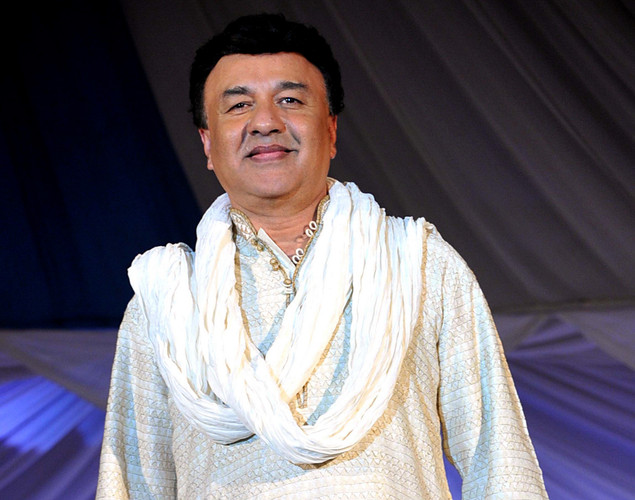 Indian Bollywood music director Anu Malik displays a creation by designer Krishna Mehta during a fashion show entitled Walk of  peace in Mumbai.