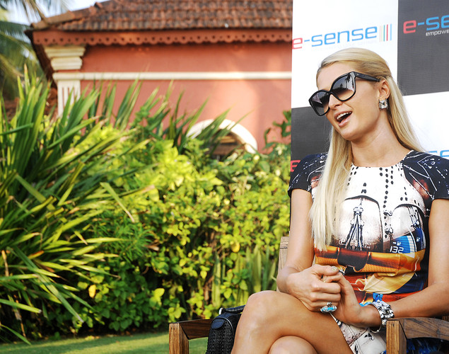 American fashion designer, socialite and business woman Paris Hilton speaks to the media at a hotel in Goa.