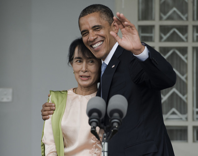 US President Barack Obama (R) and Myanmar pro-democracy leader Aung San Suu Kyi (L) speak to the media during a brief joint press conference at her residence in Yangon.