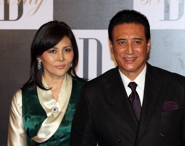 Indian Bollywood actor Danny Denzongpa (R) with his wife Gawa arrive to attend the 70th Birthday celebration of Bollywood Actor Amitabh Bachchan in Mumbai.