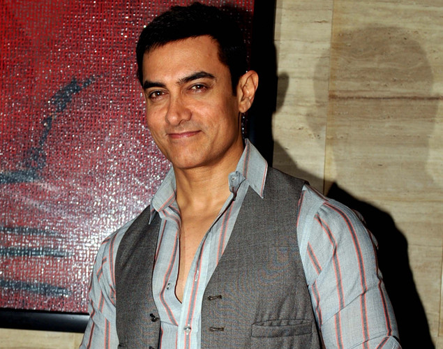 "Bollywood actor Aamir Khan poses during a party event for the Hindi film ""Talaash"" in Mumbai."